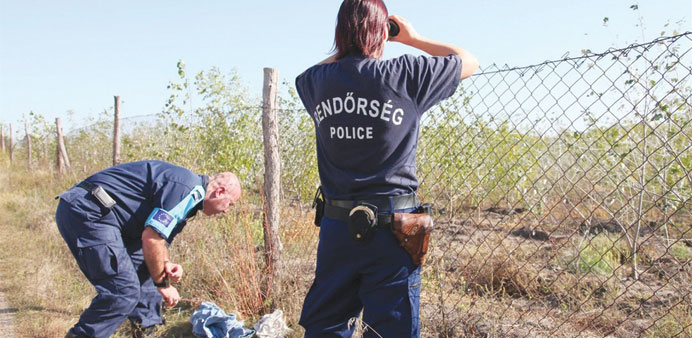 Frontex officers inspected discarded clothing at the Hungarian-Serbian border.