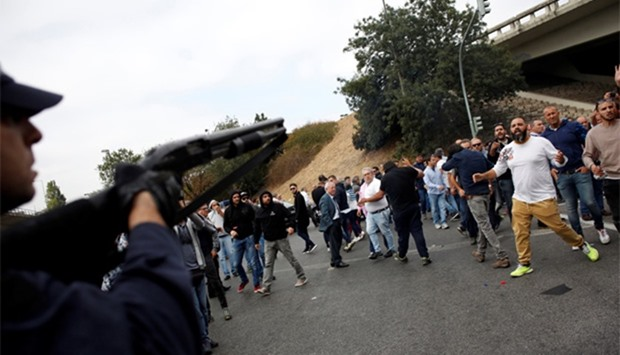 Taxi drivers face off with a policeman during a protest against Uber  in Lisbon