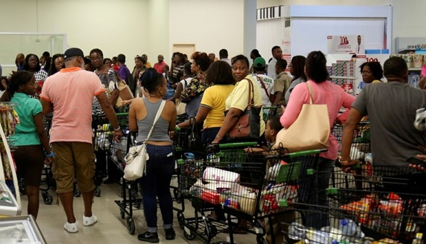 Jamaicans flock to the supermarkets to take care of last minute shopping pending the arrival of Hurr