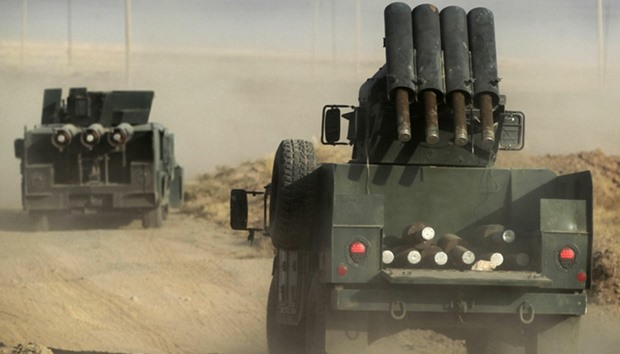 Iraqi forces advance towards the city to retake it from Islamic State