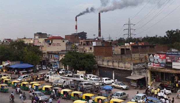 Smoke billows from the coal-based Badarpur Thermal Station in New Delhi
