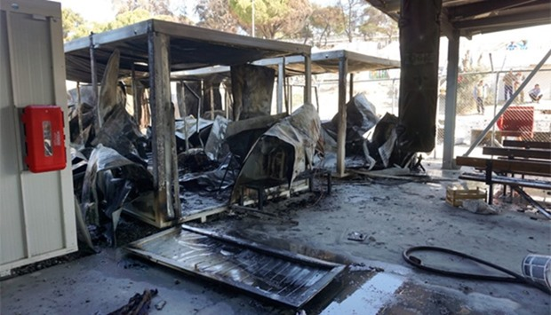 Migrants at Lesbos hurled stones and torched offices used by asylum officials
