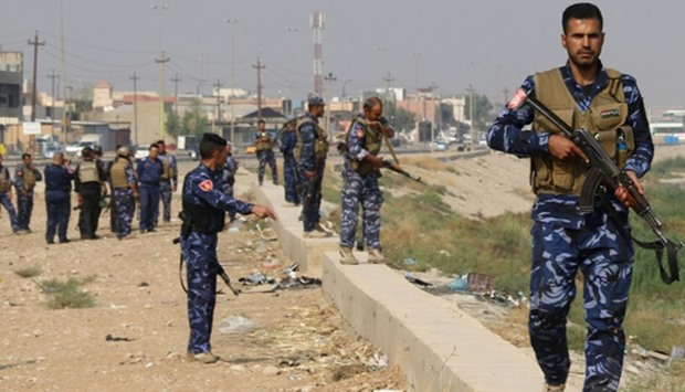 Iraqi government forces patrol the area of Kirkuk for members of the Islamic State