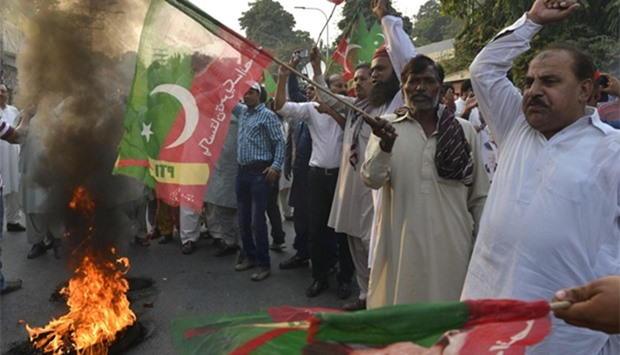 Activists of Pakistan Tehreek Insaaf party shout slogans during protest