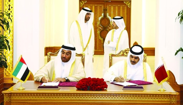 Al-Kaabi and al-Sayegh signing the new long-term gas sale and purchase agreement