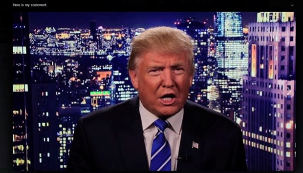 Republican US presidential nominee Donald Trump is seen in a video screengrab as he apologizes