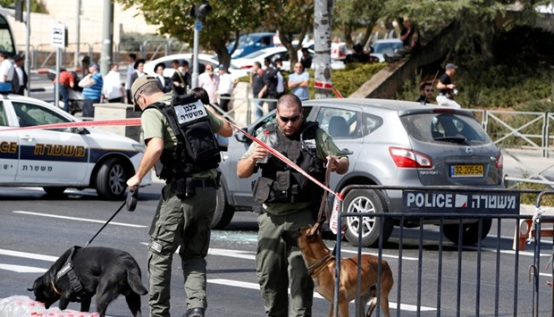 Israeli police secure the area following a shooting incident in Jerusalem