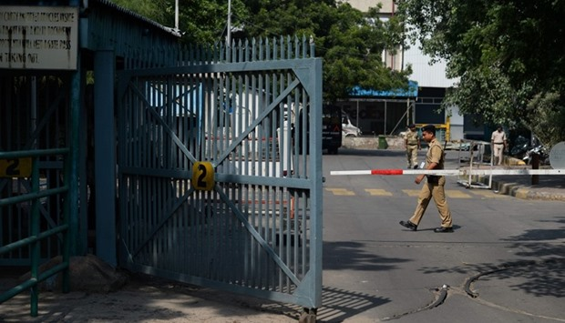 An Indian security guard stands near a barricade at New Delhi's international airport in New Delhi