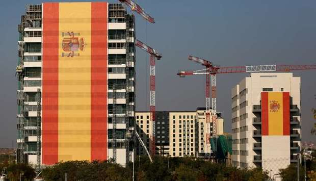 Buildings are draped in giant Spanish flags in a suburb of Madrid