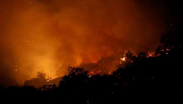 The Pocket wildfire burns in the hills above Geyserville, California