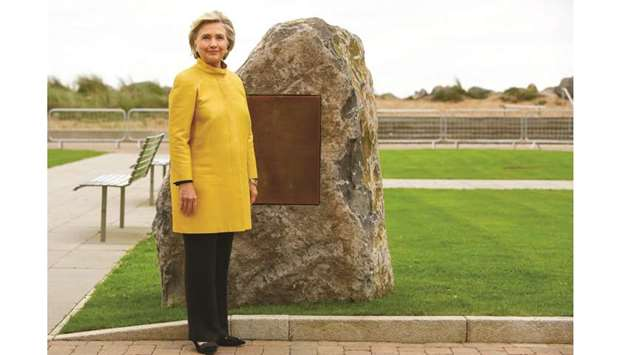 Clinton stands by a commemorative stone at the Swansea University Bay Campus, where she received an