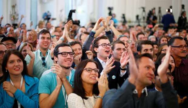 Supporters of the Peoples Party (OeVP) react after first exit polls in Vienna