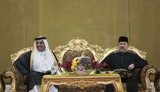 His Highness the Emir Sheikh Tamim bin Hamad Al-Thani with King of Malaysia Sultan Muhammad V
