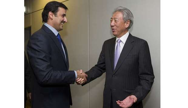 Emir being greeted upon arrival at Singapore International Changi Airport by Deputy Prime Minister o