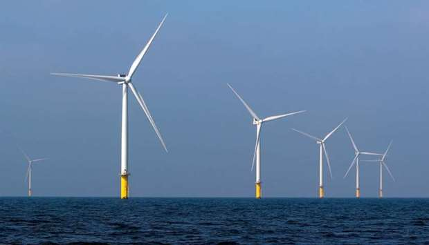 Power-generating windmill turbines are seen at the Eneco Luchterduinen offshore wind farm near Amste