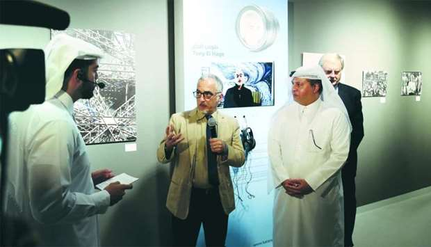 Tony Hage showing his works to Katara deputy general manager Ahmad al-Sayed, dignitaries and guests.