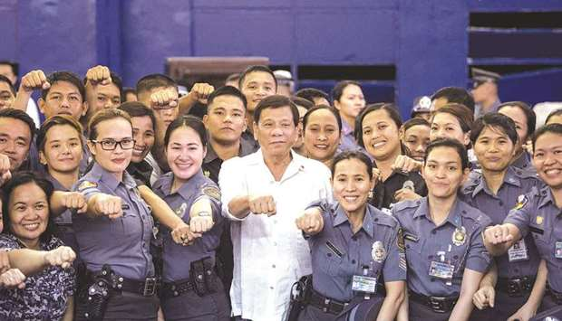 Philippines President Rodrigo Duterte posing for a picture with the Bureau of Jail and Penology Mana