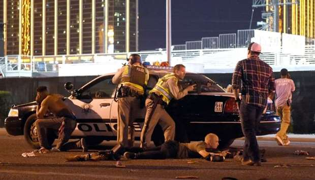 Las Vegas police stand guard along the streets outside the the Route 91 Harvest country