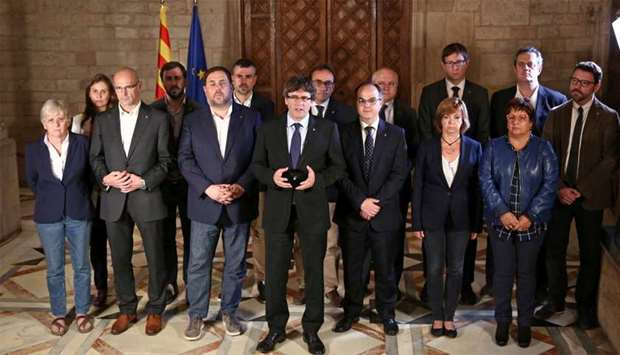 Catalan Regional President Puigdemont is flanked by members of his government