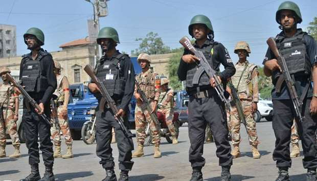 Pakistani security personnel stand guard in Karachi