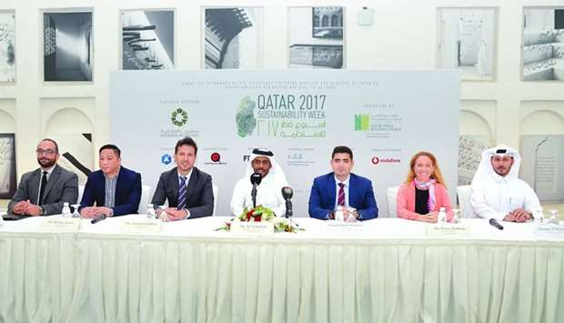 Meshal al-Shamari, director, QGBC (right) with the officials of sponsoring organisations at the pres