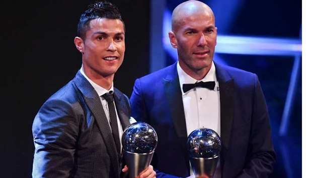 Real Madrid and Portugal forward Cristiano Ronaldo (left) poses with Real Madrid's French coach Zine