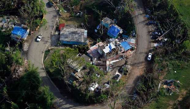 An aerial view of houses affected by the passing of Hurricane Maria in Naranjito, Puerto Rico