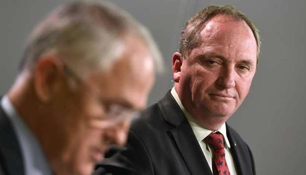 Australia's Deputy Prime Minister Barnaby Joyce (R) looking at Prime Minister Malcolm Turnbull addre