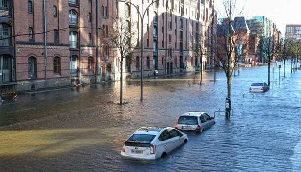 Flood waters surround cars parked at Hamburg's Fish Market district  as a storm hit many parts of Ge