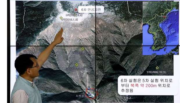 A South Korean scientist shows seismic waves taking place in North Korea on a screen at the Korea Me