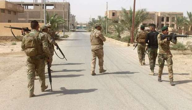 Iraqi forces members patrol during a military operation in the northwestern Anbar province