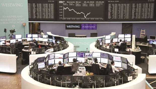 Traders at the Frankfurt Stock Exchange. The DAX 30 gained 0.3% to 11,977.22 points yesterday.