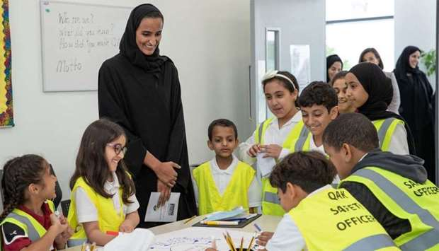 HE Sheikha Hind bint Hamad al-Thani observes the activities of the students.