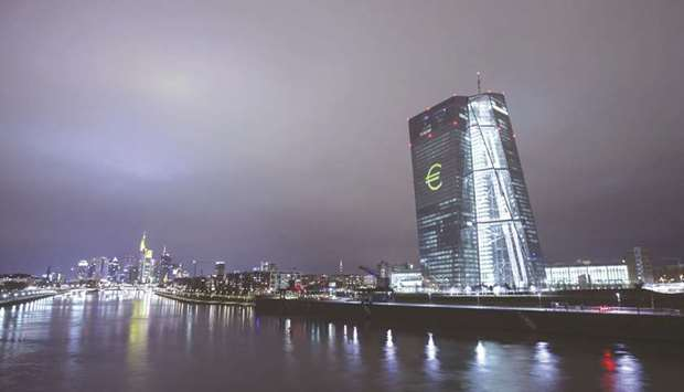 An illuminated euro currency symbol is projected on to the ECB headquarters during a light festival