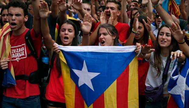 Students hold a Catalan pro-independence 'Estelada' flag during a demonstration to commemorate the a