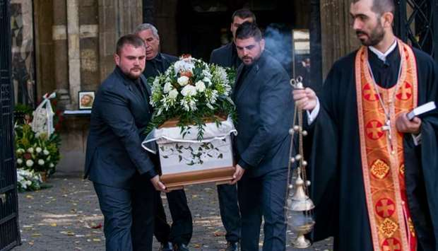 People carry the coffin of killed Bulgarian journalist Viktoria Marinova in Holy Trinity Cathedral i