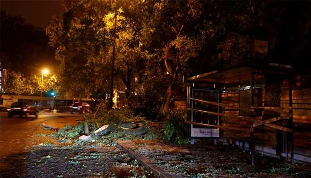 Branches of trees are seen on a street at Benfica neigborhood as hurricane Leslie goes past in Lisbo