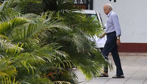 India's Minister of State for External Affairs Mobashar Jawed Akbar walks inside his residence in Ne