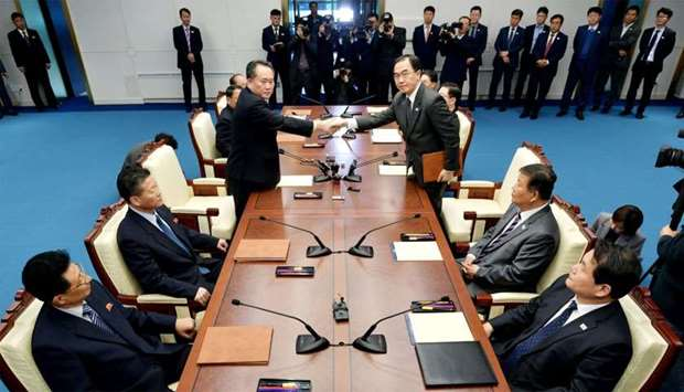 North Korea's Ri Son Gwon shakes hands with South Korean Unification Minister Cho after their meetin
