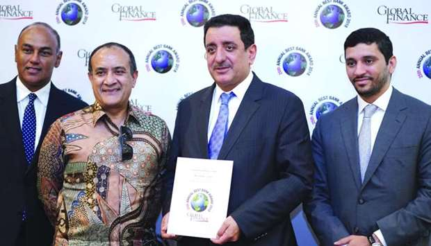 Commercial Bank board member Mohamad Ismail Mandani (second right) and Abraham (second left) with ot