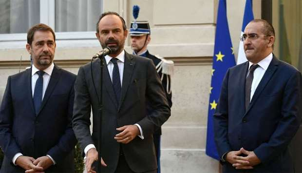 French Prime minister Edouard Philippe (C) flanked by newly appointed French Interior minister Chris