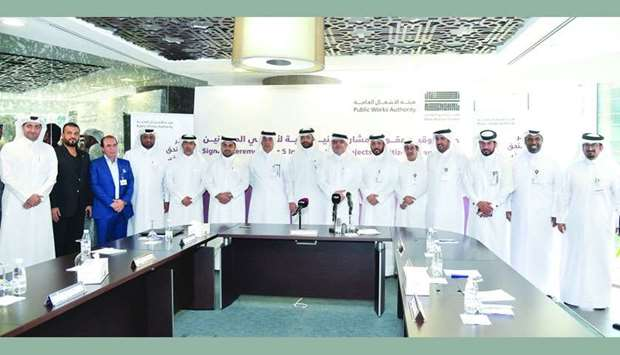 Ashghal president Saad bin Ahmed al-Muhannadi and other officials with representatives of the compan