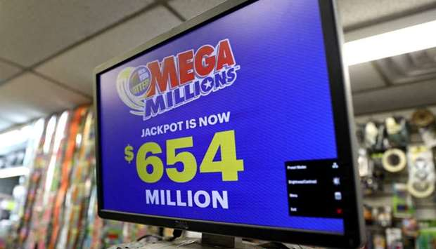 Sign displays the jackpot for Tuesday's Mega Millions drawing after it rose over $650 million in New
