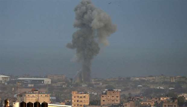 Smoke billows following an Israeli air strike around the southern Gaza Strip city of Rafah