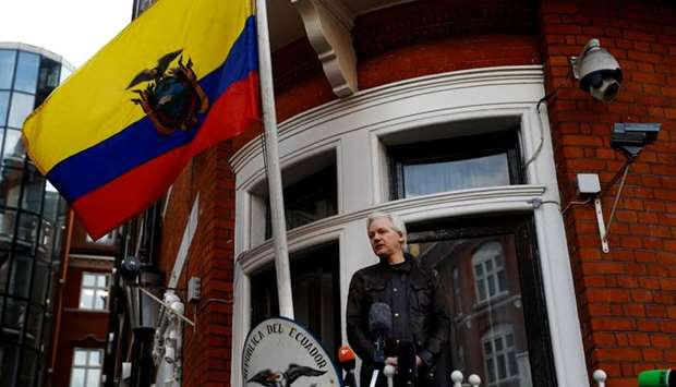Julian Assange is seen on the balcony of the Ecuadorian Embassy in London