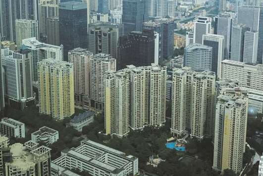 China real estate investment slows as investors drop expansion plans