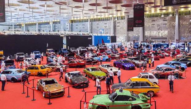 Classic and modified cars lined up at the Mawater pavilion