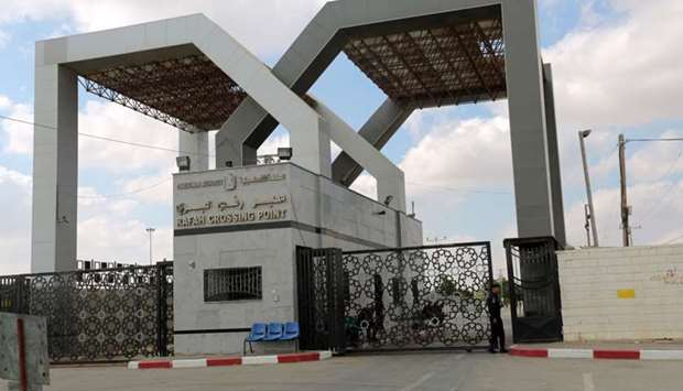 A member of the Palestinian security forces stands guard at the Rafah border crossing with Egypt in