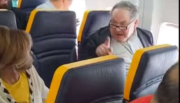 A screenshot from a video posted on social media by euronews that shows the man shouting at the woma