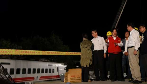 Taiwan's Premier William Lai (C) visits the site of derailed train, in Yilan,Taiwan Sunday